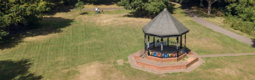 Picture shows a bandstand in the middle of a prak